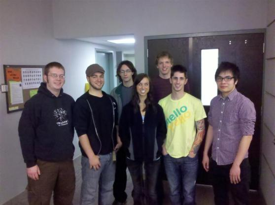 """Front row, from left to right: Dave Friday, Cory Williams, Kelsie Stevenson, Aaron Cohen, Duy """"Addie"""" Duong. Back row, left to right: Nathan Shapiro, Dean VanMiddelkoop"""