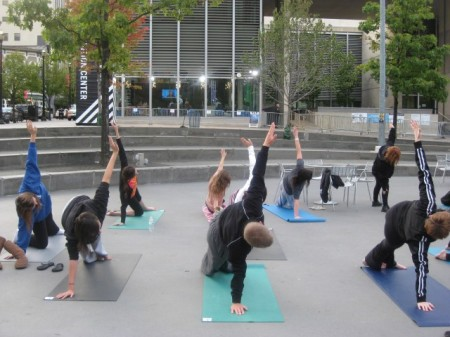 GRCC Wellness Students do Yoga in Rosa Parks Circle
