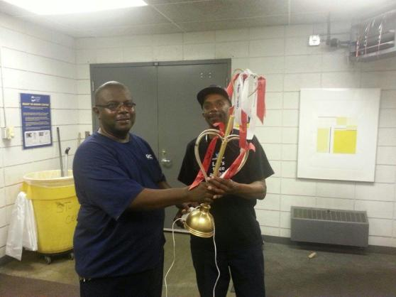 Essie McGhee passes the Golden Plunger to OB Gladyness.