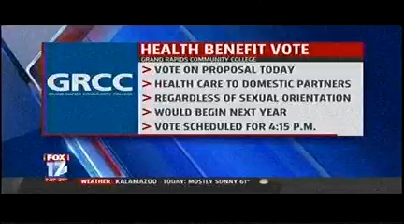 An image from a TV screen: GRCC Health Benefit Vote. Grand Rapids Community College. Vote on proposal today. Health care to domestic partners. Regardless of sexual orientation. Would begin next year. Vote scheduled for 4:15 p.m.