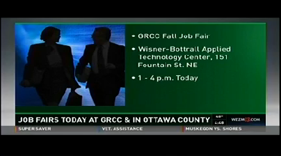A television screen shows: Job Fairs Today at GRCC & in Ottawa County. GRCC Fall Job Fair. Wisner-Bottrall Applied Technology Center, 151 Fountain St. NE. 1-4 p.m. today.