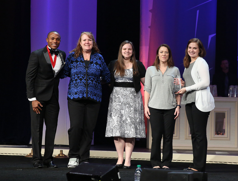 8fbaac6cf9744 A young man and four women stand on a stage. Posted in Uncategorized Tagged Phi  Theta Kappa ...