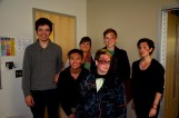 Six theater students, made up to resemble trauma patients, pose together.