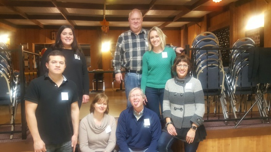 Wilfredo Barajas, Sasha Ahmed, Luba Petrash, Mike Whitman, Charlie Olawsky, Holly VanRyn and Audrey Heckwolf stand in the Fenn Valley Winery.