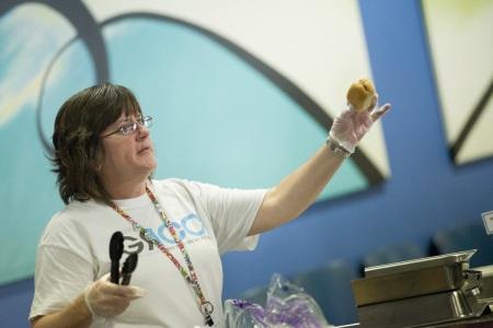 Molly Maczka serves hotdogs during Welcome Week.