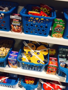 Baskets of snacks sit on shelves.