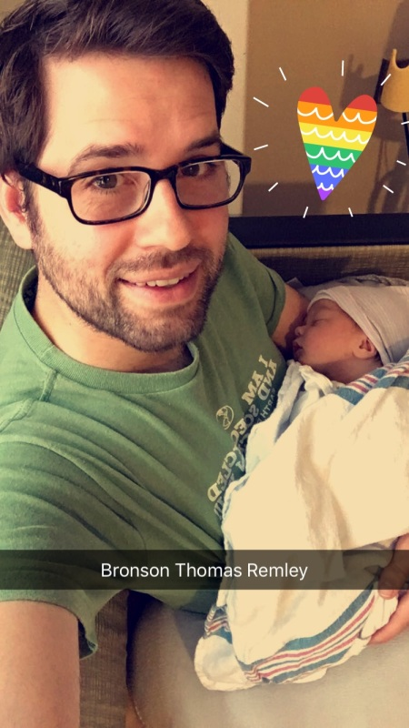 Chris Remley holds his infant son, Bronson Thomas Remley.