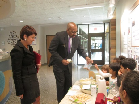 President Pink and Kathy Mullins buy cookies during the preschool's bake sale.