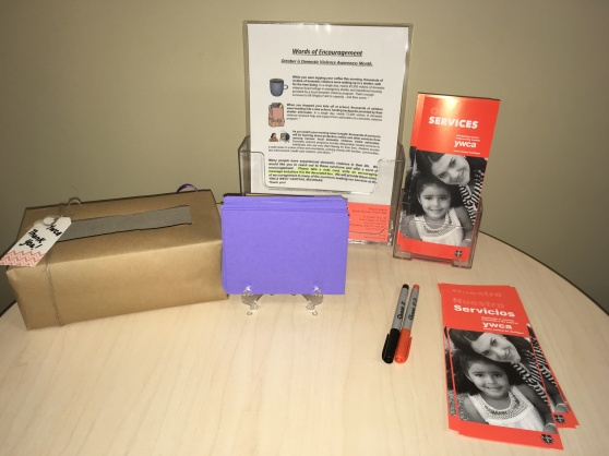 A collection box and pamphlets sit on a table in the Woodrick Center for the Words of Encouragement project.