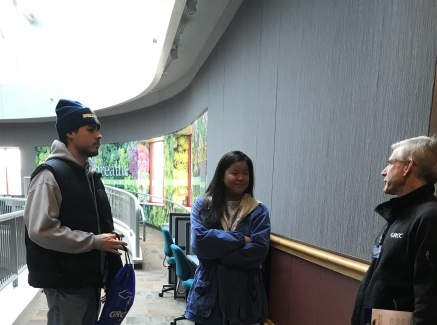 Two Kent City High School students talk to a GRCC staff member in the ATC atrium.