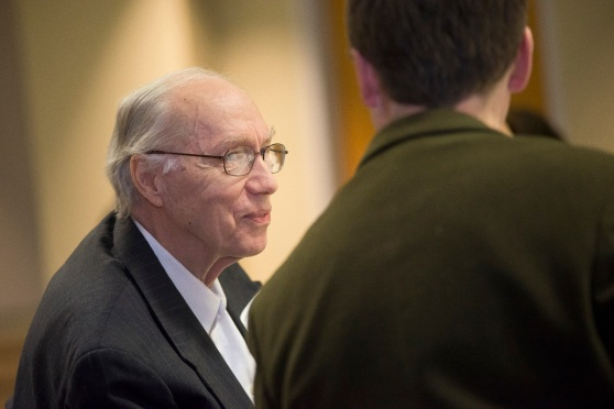 Keith Longberg talks to a student at a Creating Connections breakfast in 2015.