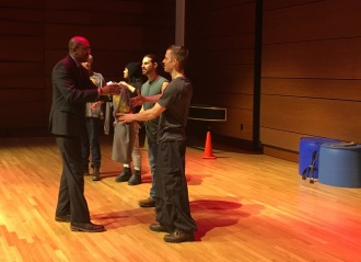 "President Pink gives GRCC T-shirts to four cast members of ""STOMP."""