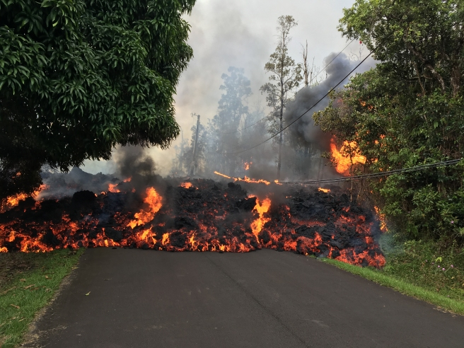 A lava flow moves on Makamae Street in Leilani Estates at 09:32 am HST on May 6. Photo courtesy of United States Geological Survey's Hawaiian Volcano Observatory