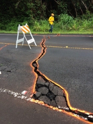 Cracks in Highway 130 at 09:30 a.m. HST May 7th. Orange paint was used to outline the cracks. The road remained closed for much of the day yesterday. Photo courtesy of United States Geological Survey's Hawaiian Volcano Observatory
