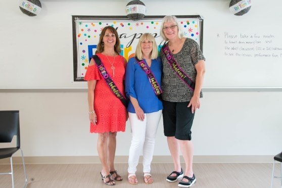 "Learning Lab instructors Cheryl Botham, Paula Kunst, and Penny Folsom pose for a retirement party photo. Each wears a sash that read ""Retired and Fabulous!"""