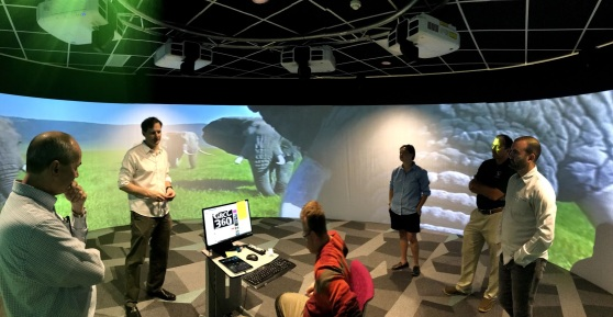 Klaas Kwant and staff inside a 360-degree projection space on the MSU HUB trip.