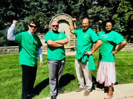 "Four green-shirted ""Tread Shredders"" pose for a photo outside during the Going the Distance at GRCC Walking Challenge"