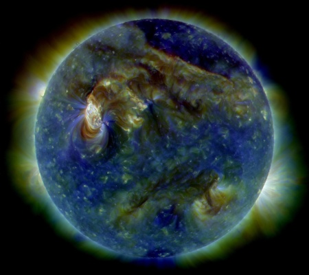 An image of the sun using Spectroscopy. The sun is depicted in shades of green, brown, and blue.