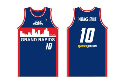 "A graphic of the front and back sides of the special jerseys the Grand Rapids Drive will be wearing Friday night. Jerseys are blue with red trim, a red stripe on the front with the Grand Rapids skyline in white above the words ""Grand Rapids,"" and the words ""Raider Nation"" on the back. The player's number is displayed on both front and back. There is a logo for the GRCC Raiders on the front and logos for both the NBA and the G League on the back."