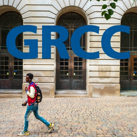 "GRCC square profile image. A student in a red jacket is walking past the doors of Main. ""GRCC"" is in the top half of the image."