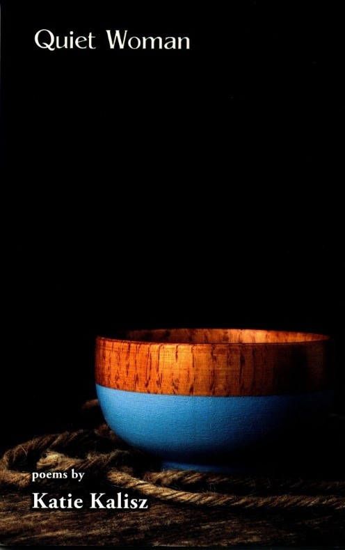 "The cover of the poetry book 'Quiet Woman' by author Katie Kalisz. The cover depicts a black background. There is a small wooden bowl with a blue base sitting on a wooden surface in the foreground. Around the bowl's base is a loosely-coiled pile of rough thick twine. The text reads: ""Quiet Woman. Poems by Katie Kalisz."""