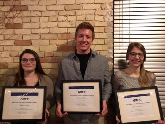 GRCC's 2018-2019 Physical Sciences Students of the Year winners Madison Jones, Andrew Hulsman, and Janine Sweetman posing for a photo while holding their framed certificates.