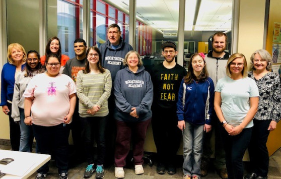 GRCC students and instructors stand with Noorthoek Academy students, whom they helped with computer skills.