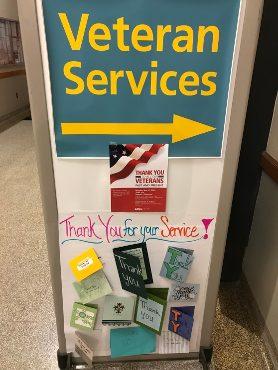 Handmade cards are attached to a sign for GRCC's Veterans Services office.