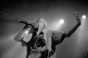 Rakim singing into a microphone.