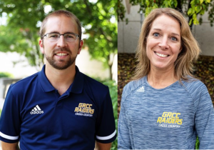 Assistant Coach Garrett Lacey and Assistant Coach Sharon Becker smiling at the camera.