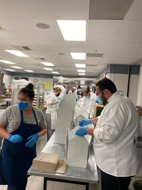 Culinary students assemble boxes for the lunches.