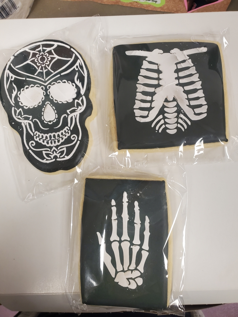 Cookies are decorated with a skull, hand bones and a ribcage.