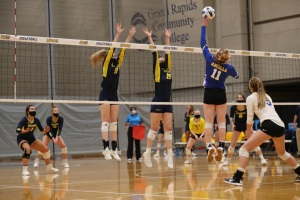 GRCC volleyball team playing volleyball.