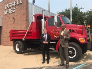 Kentwood mayor and President Pink standing in front of a donated Public Works vehicle.