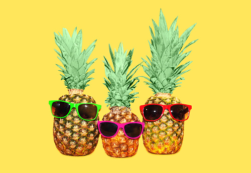 Three pineapple with sunglasses.