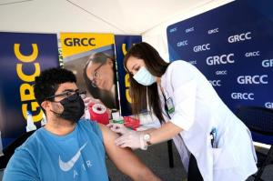 Student getting a vaccine at the vaccine pop-up clinic.