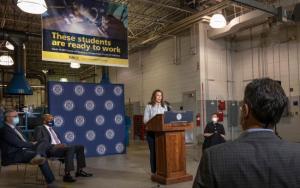 Michigan Gov. Gretchen Whitmer, behind a podium, speaking.