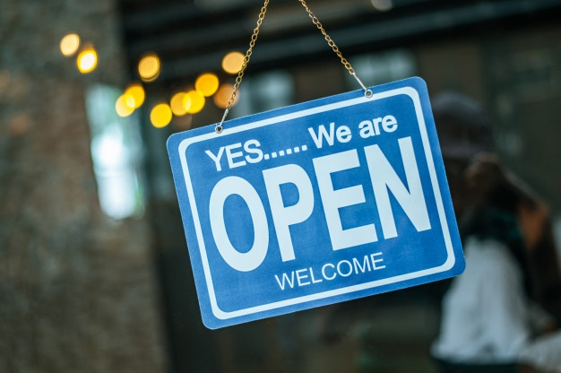 Sign stating: Yes we are open, welcome.