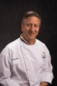 Dan Gendler in Culinary Department shirt, smiling.