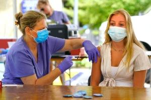 Student getting a Covid vaccine.