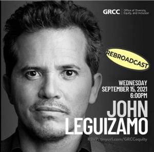 John Leguizamo smiling.